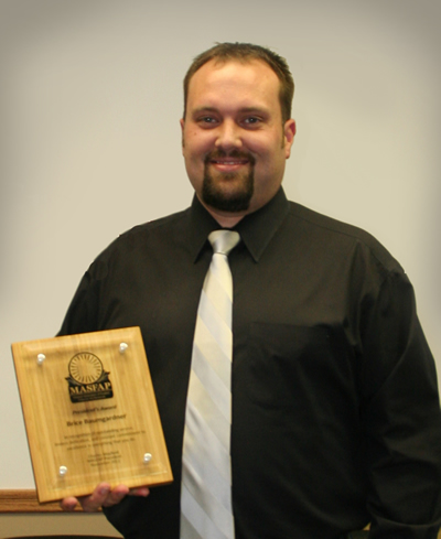 Brice Baumgardner with Award