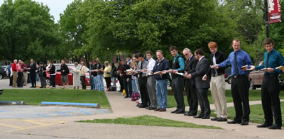 Faculty, Staff, and Friends form a human chain