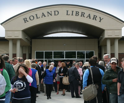 The crowd gathers in front of the library after the dedication